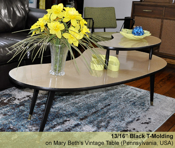 black t-molding on a vintage table